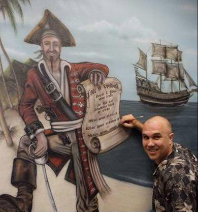 airbrushing pirate mural